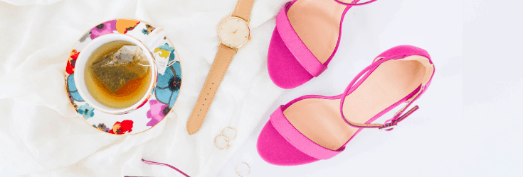 Tea cup, watch and pink shoes