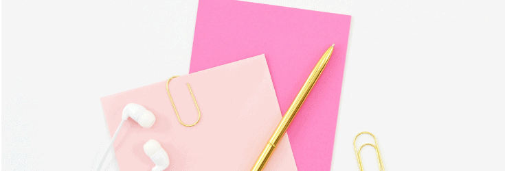 Pink notebpoks and a gold pen