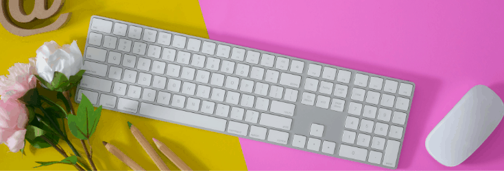 wireless keyboard on pink and yellow desk